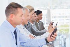 Business team using their mobile phone Stock Photos