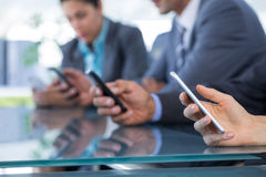 Business team using their mobile phone Stock Images
