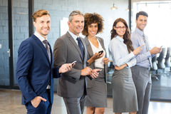 Business team using their mobile phone Stock Photo