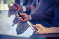 Business team using their smartphones Stock Images