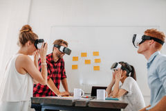 Business team using virtual reality headset in meeting Stock Images