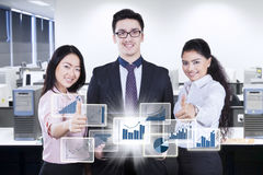 Business team with virtual financial growth in workplace Stock Photography