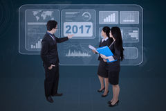 Business team with virtual screen on meeting Royalty Free Stock Image
