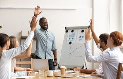 Free Business Team Voting Concept, African Coach And Employees Raise Hands Stock Images - 144855494