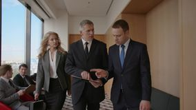 Business team walking with documents stock footage