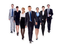 Business team walking forward. Leadership and teamwork concepts using a group of businessmen and businesswomen isolated on white stock image