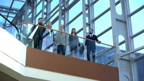 Business team walking in glass building. Business team walking in modern glass office building