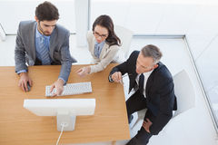 Business team watching a computer screen Stock Image