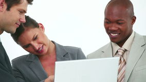 Business team watching a laptop screen Royalty Free Stock Images