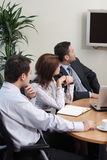 Business Team watching tv Stock Photo