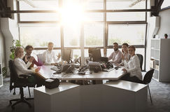 Business team waving hands at office. Corporate, technology and people concept - business team with smartphones and computers waving hands at office royalty free stock photos