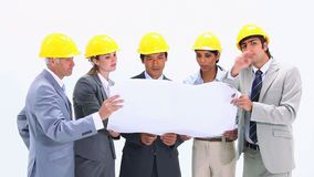 Business team wearing safety helmet Stock Images