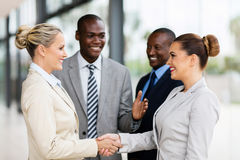 Business team welcoming businesswoman. Cheerful business team welcoming businesswoman stock images