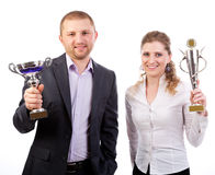Business team  winner with a trophy. Isolated on white background Royalty Free Stock Photography
