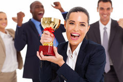 Business team winning. Excited business team winning a trophy Royalty Free Stock Photos