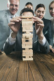 Business team with wood puzzle Royalty Free Stock Image