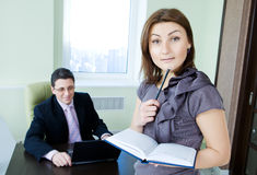 Business team at work. Business assistant with boss Stock Image