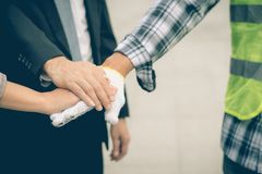 Business team work concept : business people hold hand together. Professional agreement partnership community ,selective focus Stock Photo