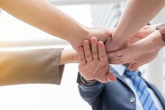 Business team work concept : business people hold hand together. Professional agreement partnership community ,selective focus Royalty Free Stock Images