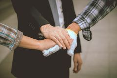 Business team work concept : business people hold hand together. Professional agreement partnership community ,selective focus Stock Images