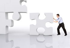 Business team work puzzle Stock Photos