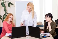 Lesson teacher school table computer business team work space class mate group woman 50 plus stock photography