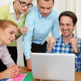 Business team work together. Looking at one laptop at workplace Royalty Free Stock Photo