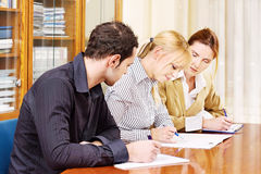 Business team work together in office. Business team, men and two women work together in office Stock Photos
