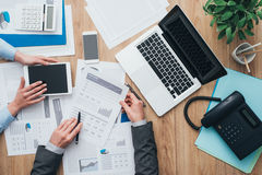 Business team at work. Business team working at office desk and analyzing financial reports, finance and accounting concept, top view Stock Photo