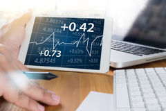 Business Team Workin economics and Graphs Interfaces market stoc. K Project Manager Researching Process Global Strategy Virtual Innovation  k Project Manager Stock Photo