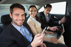 Business team working in the back seat. In the car Stock Image
