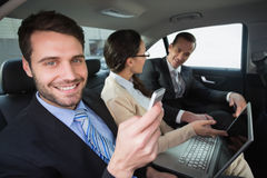 Business team working in the back seat. In the car Royalty Free Stock Images