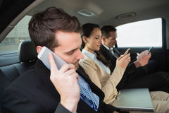 Business team working in the back seat. In the car Stock Photography