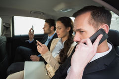 Business team working in the back seat. In the car Stock Images