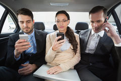 Business team working in the back seat. In the car Stock Photo