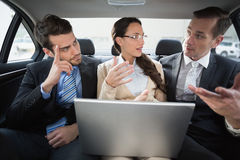 Business team working in the back seat. In the car Royalty Free Stock Image