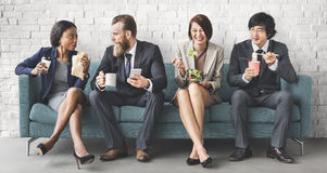 Business Team Working Break Eating Lunch Concept. A diverse group businesspeople eating royalty free stock photography