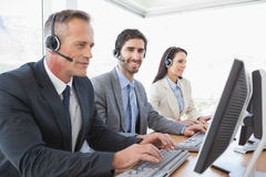 Business team working at a call center Stock Image