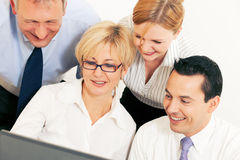 Business team working on computer Stock Photography