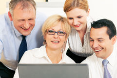 Business team working on computer Royalty Free Stock Photos