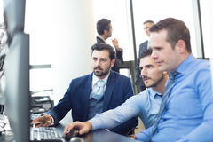 Business team working in corporate office. Stock Images