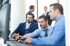 Business team working in corporate office. Stock Photos