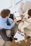 Business team working on the couch scheduling in diary Stock Photos