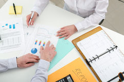 Business team working on financial graphs Stock Photo
