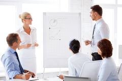 Business team working with flip chart in office Stock Images