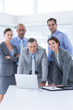 Business team working happily together on laptop Stock Photography