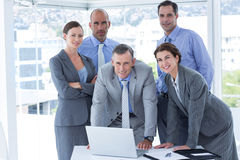 Business team working happily together on laptop Royalty Free Stock Images