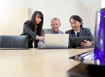 Business team working on laptop royalty free stock photo
