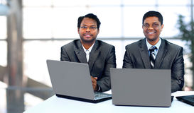 Business team working at laptop Stock Photos