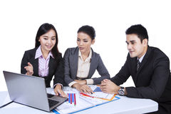 Business team working with laptop - isolated Stock Image